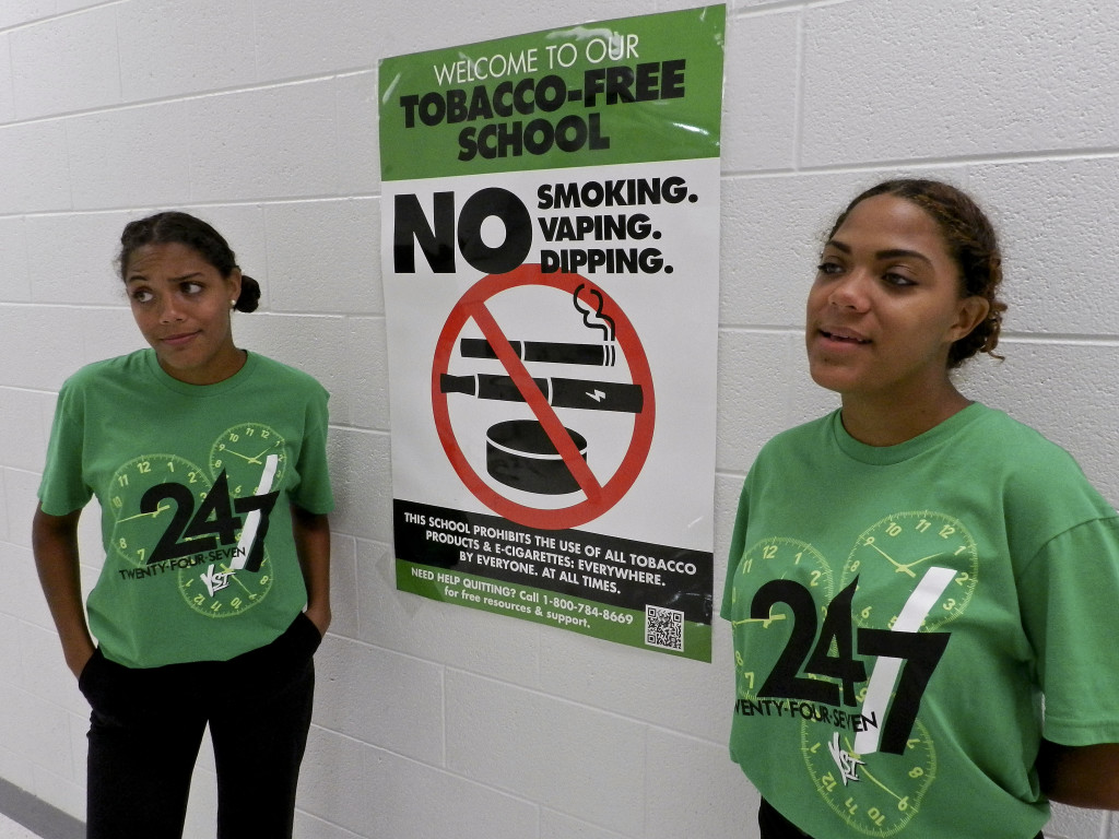 Sarah, left, and Hannah Chichester talk about the signs they've posted around Skyline High School. Rachel Mahoney/Daily