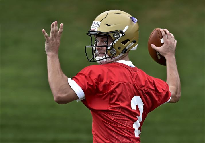 James Madison University's Connor Mitch throws a pass during practice this summer. The transfer from the University of South Carolina is battling with Bryan Schor for the starting quarterback spot. Courtesy photo/JMU Athletics Communications