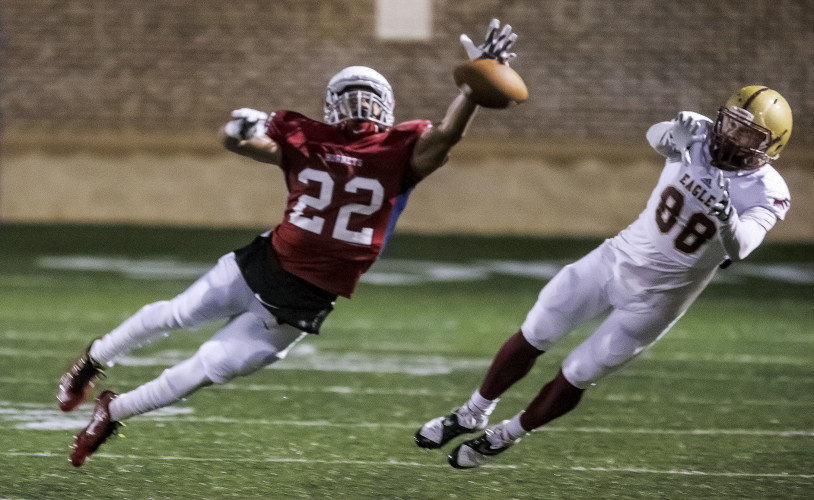 Shenandoah cornerback Weldon Gilchrist Jr. swats away a pass intended for Bridgewater's Peter Monteleone during a game at Shentel Stadium in Winchester last season.   Photo courtesy of Shenandoah University