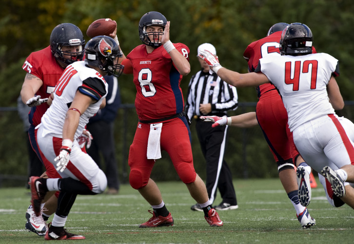 Shenandoah University quarterback Hayden Bauserman looks for a receiver during second half action against Catholic Saturday at Shentel Stadium in Winchester.  Rich Cooley/Daily