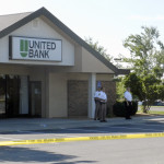 Frederick County Sheriff Lenny Millholland, center, stands in front of the United Bank branch where an attempted robbery was reported Wednesday morning. Nathan Budryk/Daily