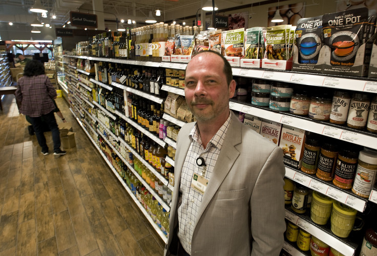 Tom Sanders, store manager for Fresh Market in Winchester, stands beside a stocked aisle in  the new store on Pleasant Valley Road. The store is scheduled to open on  Wednesday.  Rich Cooley/Daily