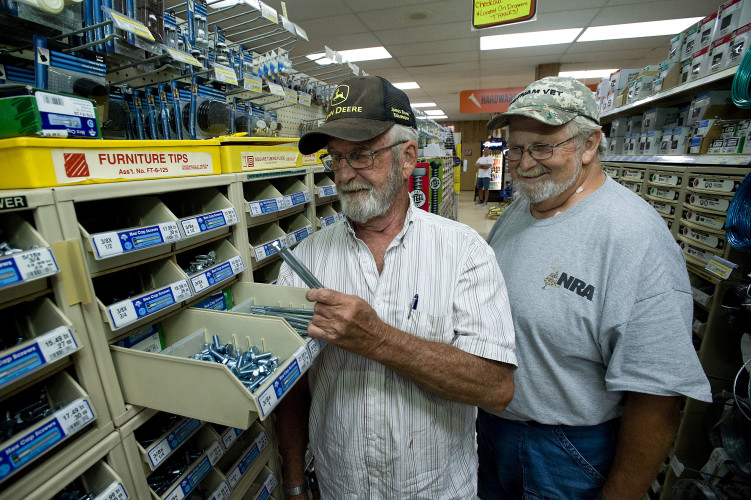 Jack Zerkel, left, and his brother Ronnie look through a drawer of bolts inside their hardware store in Mount Jackson. The store will celebrate its 70th anniversary this month. Rich Cooley/Daily
