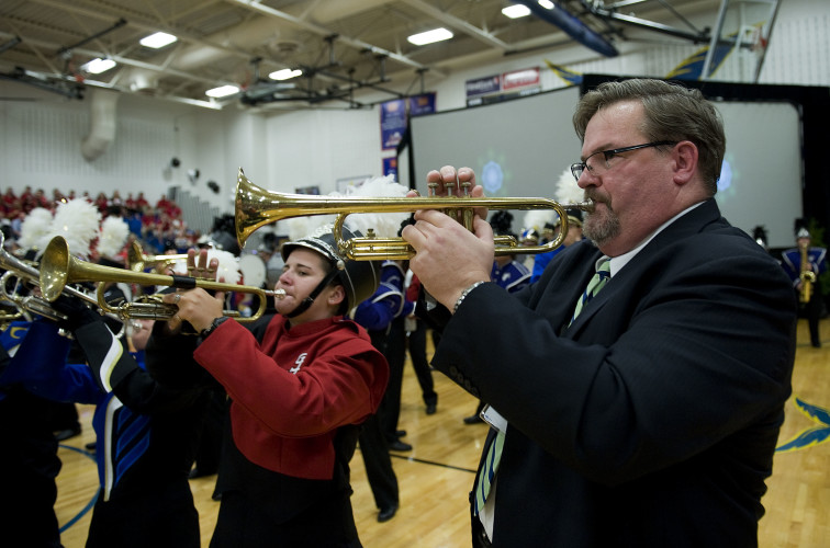 New Shenandoah County Public Schools Superintendent Mark Johnston joins students from the county high schools with his trumpet during the opening of the divsion's convocation on Friday at Central High School in Woodstock. Rich Cooley/Daily