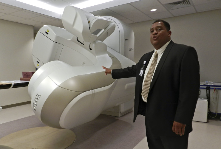 Cori Ashton, director of oncology operations at Valley Health's new cancer center, explains how the new linear accelerator works in the Radiation Oncology department.  Kaley Toy/Daily