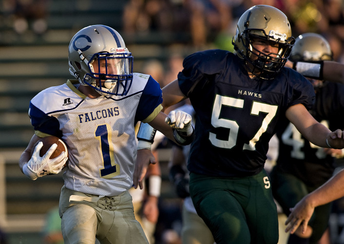 Central's Kyle Clanton runs for the sidelines as he is chased by Skyline's Justin Jenkins during their game Friday night in Front Royal. The Falcons play at Stonewall Jackson this week. Rich Cooley/Daily