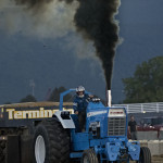 Jason Mellott, of Chambersburg, Pennsylvania, barrels down the track with his Ford 9000 during the tractor pull on Saturday night at the Shenandoah County Fair. Rich Cooley/Daily