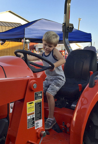 Brant Kibler dreams of driving his dad's tractor at the Shenandoah County Fair. Photo courtesy of Cathie Taylor