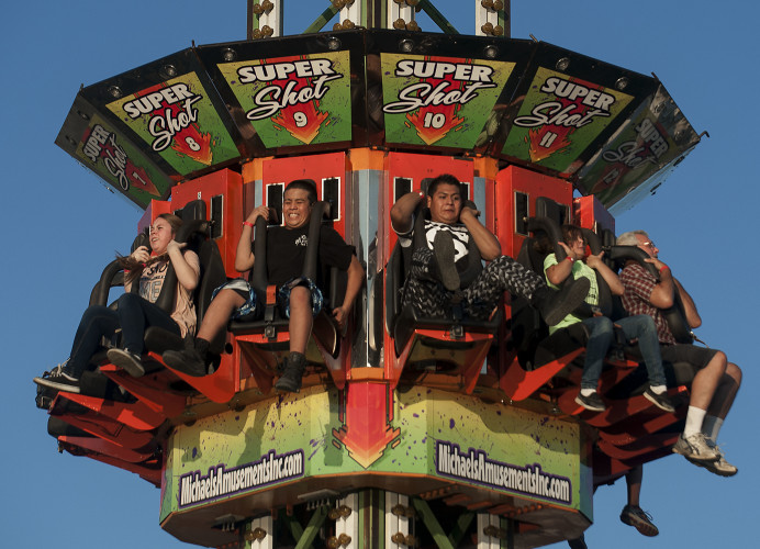 Fairgoers prepare for the drop in the Super Shot II at the Shenandoah County Fairgrounds. Rich Cooley/Daily