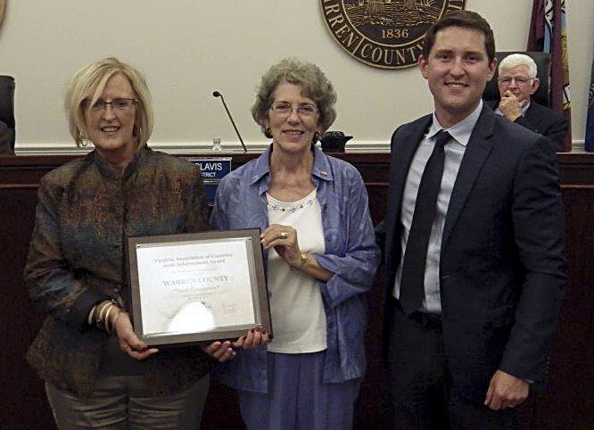 Beau Blevins, right,   presents the Virginia Association of Counties  Achievement Award to Beth Reavis, left, chairman of the Youth Advisory Board and director of the Warren County Department of Social Services, and Linda Glavis, chairman of the Warren County Board of Supervisors. Courtesy photo