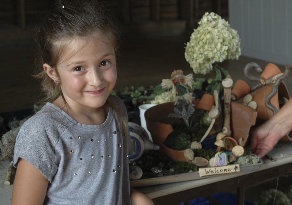 Leigha Dirting, 5, of Edinburg, attended the recent Belle Grove Barn Series class on how to use succulents and moss to create a dish garden to attract fairies.  Leigha She attended the class with her grandmother, Jennifer Mantz, of Fort Valley. The class was conducted by Master Gardener Angie Hutchinson. The next class will be held Sept. 11 on preserving garden memories. Photo courtesy Lynn Hoffman
