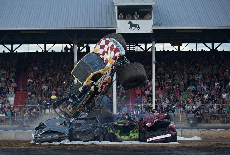 The Black Stallion monster truck, driven by Michael Vaters of Hagerstown, Maryland, starts to overturn on its top during the Vaters Motorsports Monster Truck Show on Saturday night at the Shenandoah County Fair.  Vaters was not injured. The show was the fair's final event for the season. Rich Cooley/Daily