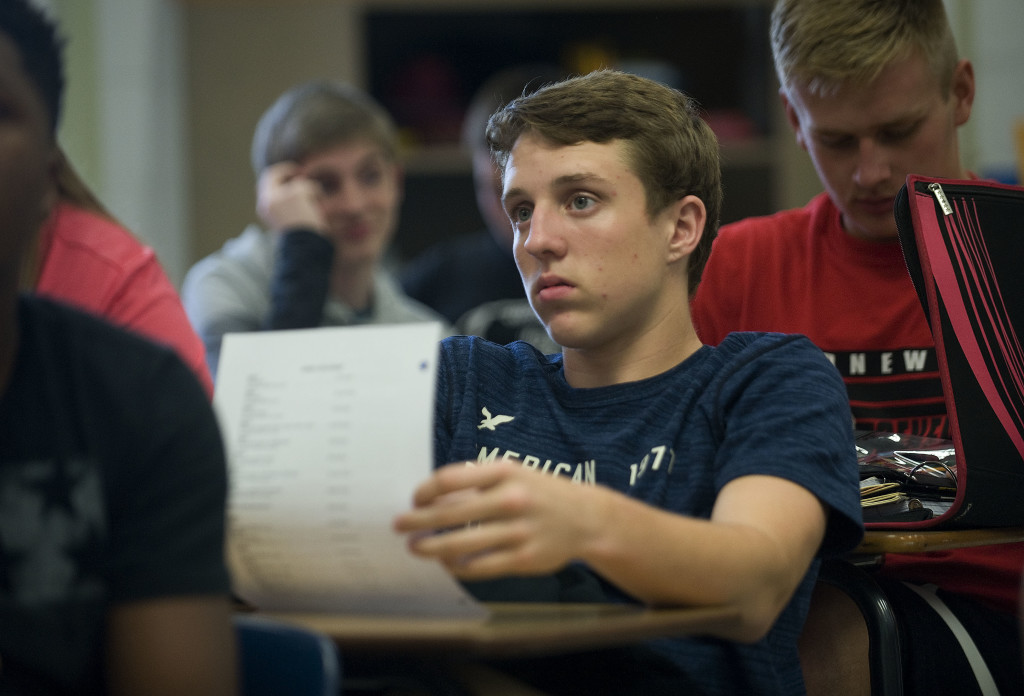Cody Cline, 15, of Edinburg, looks over the  course syllabus for his world history class during his first day of school at Stonewall Jackson HIgh School in Quicksburg on Tuesday. Rich Cooley/Daily