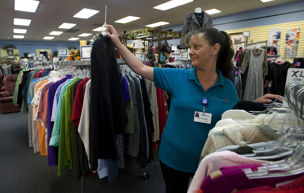 Samantha Markley, thrift store manager for Blue Ridge Hospice, checks a garment on the rack inside the Strasburg store off East King Street. Blue Ridge Hospice is celebrating its 35th anniversary.  Rich Cooley/Daily
