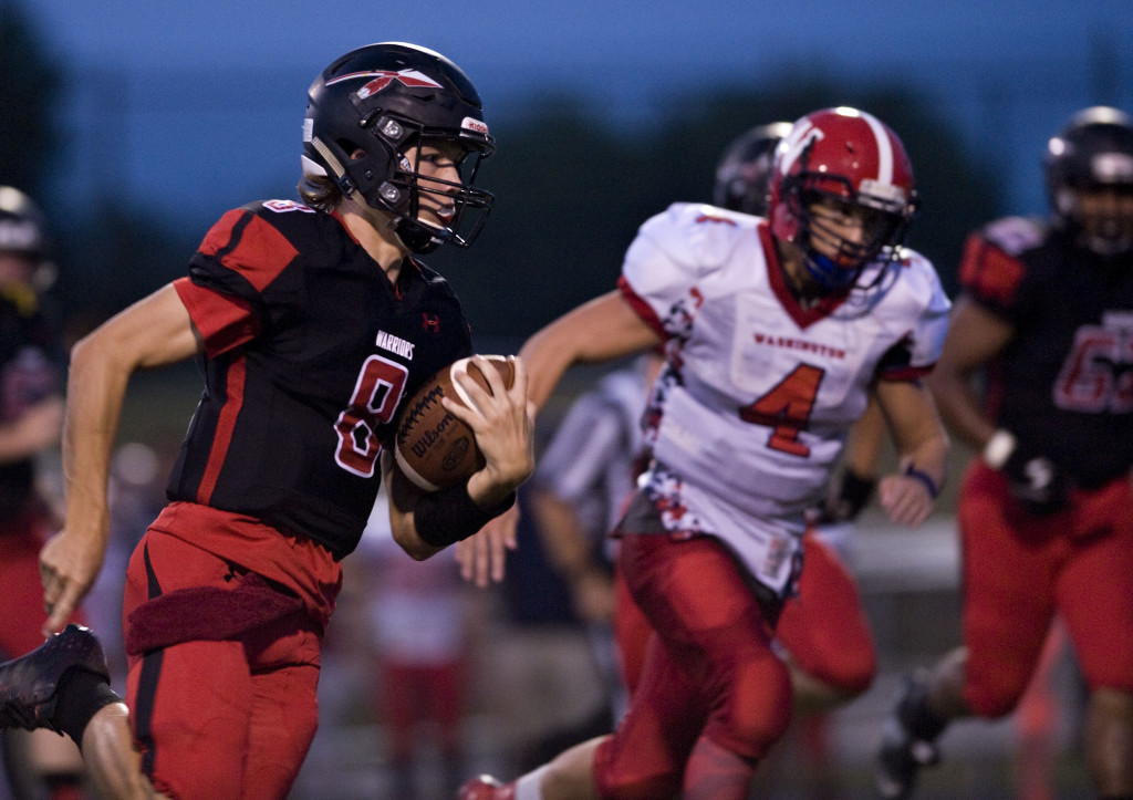 Sherando quarterback Hunter Entsminger scrambles for yardage as Washington's Jace Bradbury takes chase during their game on Sept. 9. Sherando plays at Fort Hill tonight. Rich Cooley/Daily file