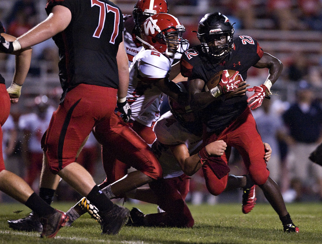 Sherando's T.J. Washington turns the corner as Washington's Dmonyaeh Jennings attempts to make a tackle. The Warriors play at Eastern View on Friday. Rich Cooley/Daily
