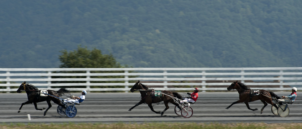 Drivers round the turn before the final line at Shenandoah Downs during a Saturday race in September. Rich Cooley/Daily
