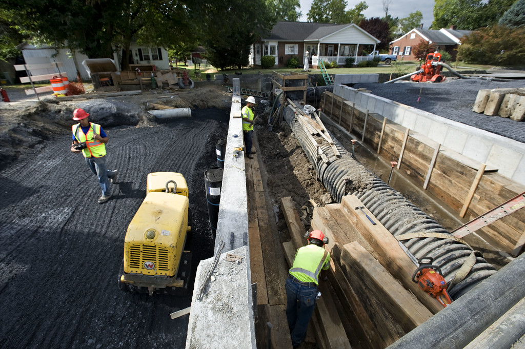 Construction workers continue working on the Queen Street project in Strasburg. Crews are working where a bridge will be placed over the Town Run. The $2.2 million project is scheduled to be completed in November. Rich Cooley/Daily