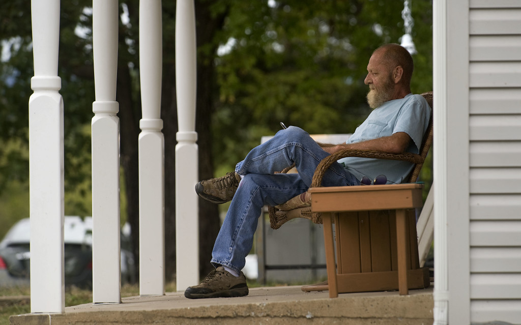 Orville Racey, 63, of Strasburg, relaxes on his porch on West Queen Street in Strasburg on a recent afternoon.  Rich Cooley/Daily