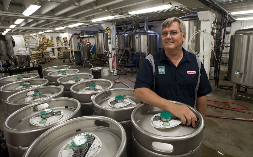 Karl Roulston, lead brewer and one of the eight owners of the Woodstock Brewhouse,  stands in the basement of their Court Street facility that houses the brew-making equipment.  Rich Cooley/Daily