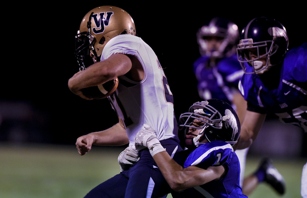 Strasburg's Justin Rickard hauls in James Wood's Keegan DeHaven during their game in Strasburg on Sept. 16. The Rams play at George Mason this week.  Rich Cooley/Daily file