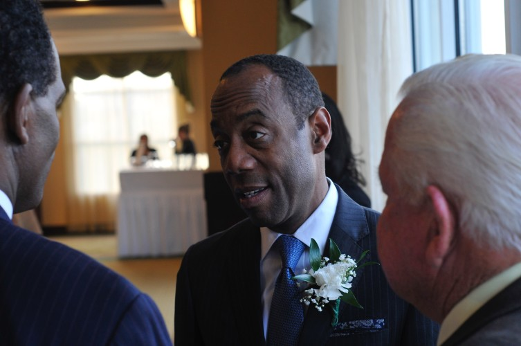 Cornell William Brooks, NAACP national president and CEO , center, speaks with with Chuck Smith, left, candidate for Virginia attorney general,  and Warren County Supervisor Daniel J. Murray Jr., right. Jake Zuckerman/Daily