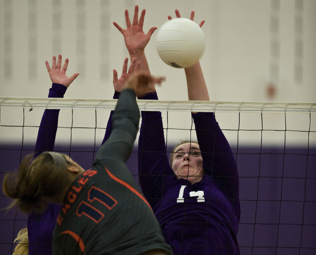 Strasburg's Daniella Henry goes up to block a kill by Clarke County's Javonna Lansdown during a Tuesday night volleyball match at Strasburg.  Rich Cooley/Daily
