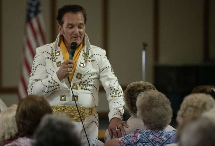 Elvis impersonator Richard Parker, of Browntown, entertains senior citizens during the Senior Choices seminar held Thursday at the Woodstock Moose. Rich Cooley/Daily
