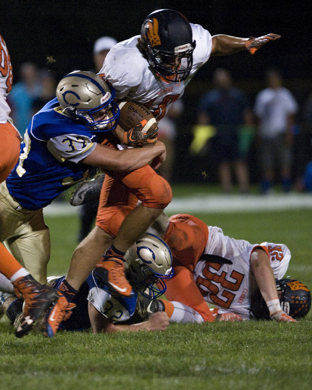 Central's Marshall McAboy hauls down Clarke County's Daniel Braithwaite for no gain on a rushing play on Sept. 23 in Woodstock. The Falcons play at Warren County at 7 tonight. Rich Cooley/Daily file