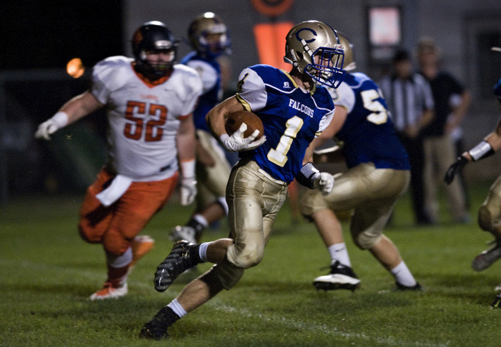 Central's Kyle Clanton turns the corner for a big gain against Clarke County on Sept. 23 in Woodstock. The Falcons play at East Rockingham tonight in the second round of the playoffs. Rich Cooley/Daily file
