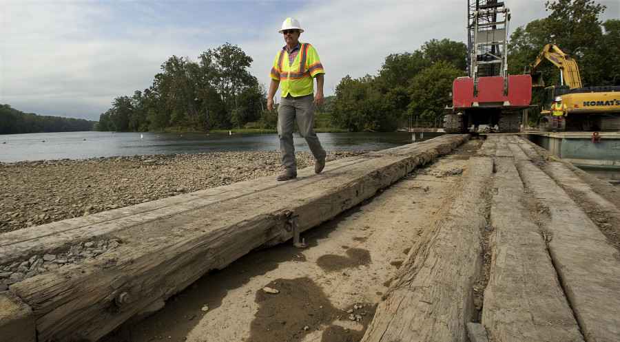 Tim Cooper, a VDOT bridge inspector, walks over the wooden timbers that remain on half of the existing Morgan Ford Bridge in Warren County. The new bridge, constructed by Orders Construction Company Inc., of St. Albans, West Virginia, is scheduled to be completed in spring 2018. Rich Cooley/Daily