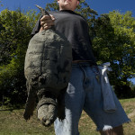 Zachary Runyon, 23, of Strasburg  walks with this snapping turtle he caught in a pond in Strasburg on Tuesday. The Massanutten Manor resident was on his way home to fix his supper.  Rich Cooley/Daily