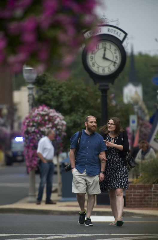 Rob and Louise Rothwell of London, England, walk along East Main Street in Front Royal on Thursday. The couple were in town to visit Skyline Drive in Shenandoah National Park. Rich Cooley/Daily