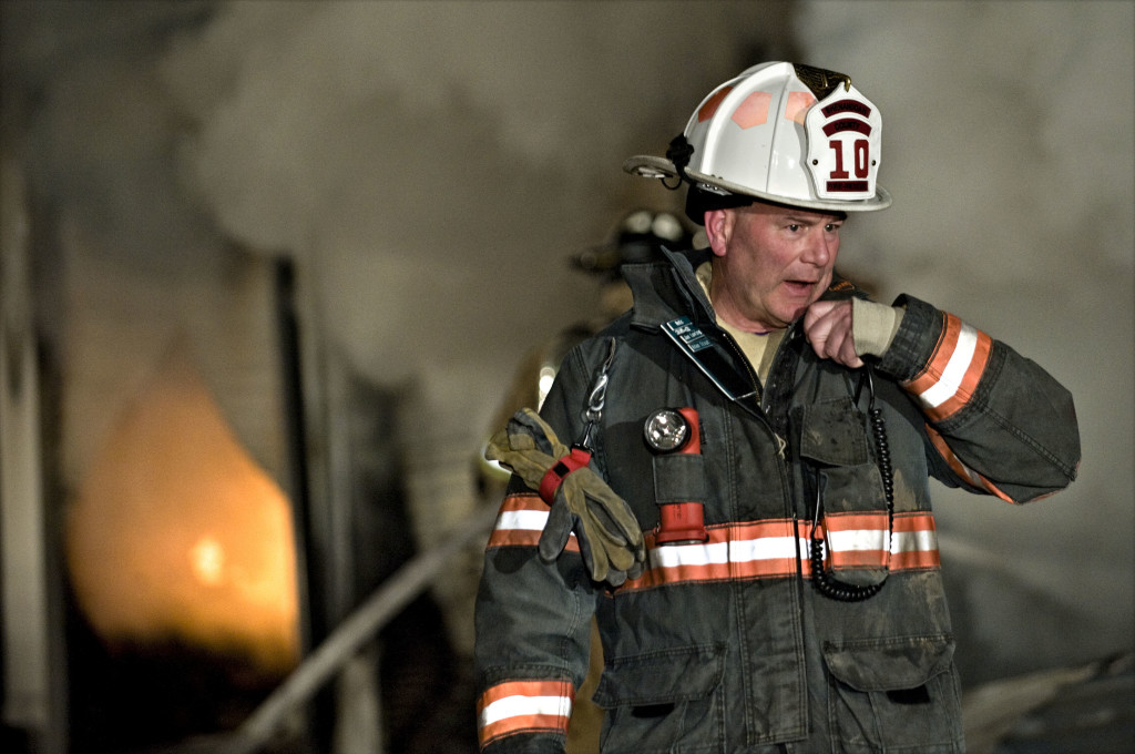 Shenandoah County Fire and Rescue operations chief Tim Williams talks on his radio while crews fight a 2014 fire at Strasburg Self Storage Fire off  Quarry Lane. Shenandoah County named Williams chief Thursday as a replacement for Gary Yew, who retired Sept. 1.   Rich Cooley/Daily