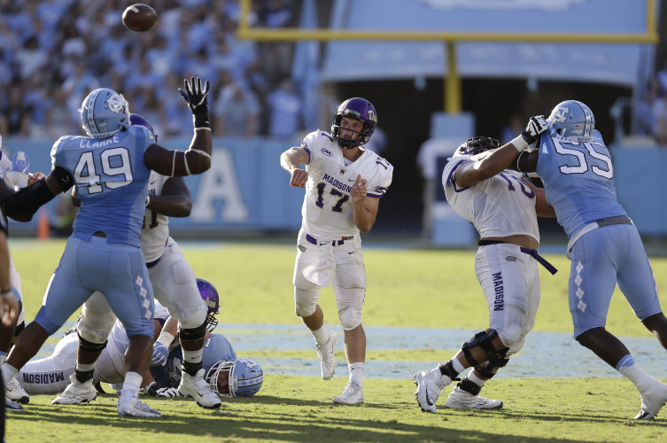 James Madison quarterback Bryan Schor passes in the first half of an NCAA college football game against North Carolina in Chapel Hill, N.C., on Sept. 17.  AP