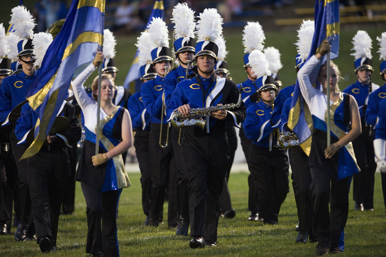 Central High School band members march off the field on Sept 23 after playing the national anthem during the Central-Clarke County football game. The high school recently purchased new uniforms for the band through school funds and donations from throughout the community. Rich Cooley/Daily