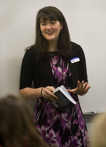 "Lord Fairfax Community College English professor Jenni VanCuren speaks about her recently published novel, ""When Shadows Fade,"" during a recent gathering at the college. Rich Cooley/Daily"