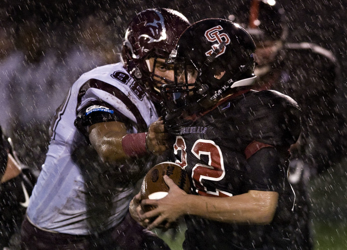 Stonewall's Logen Patton runs out of room as Stuarts Draft's John Gumann prepares to tackle him during first quarter action Friday night in Quicksburg.    Rich Cooley/Daily
