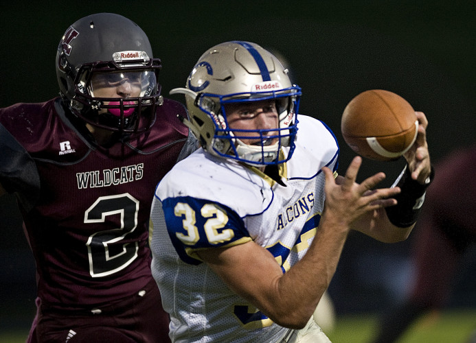 Central's Matt Bromley hauls in a pass as Warren County's Brian Dickerson pursues him during a game on Oct. 3 in Front Royal. Rich Cooley/Daily