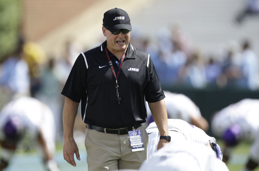 James Madison University head coach Mike Houston walks on the field Sept. 17 prior to JMU's game against North Carolina in Chapel Hill, North Carolina. JMU hosts William & Mary today. AP file