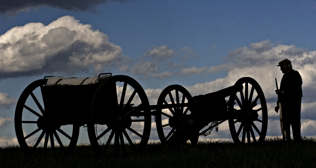 John Davison, 67, of Cabin John, Maryland, stands alongside a cannon at Cedar Creek Battlefield in this photo taken during last year's encampment in October. The 152nd  anniversary of the Battle of Cedar Creek will take place this weekend in Middletown.  Rich Cooley/Daily