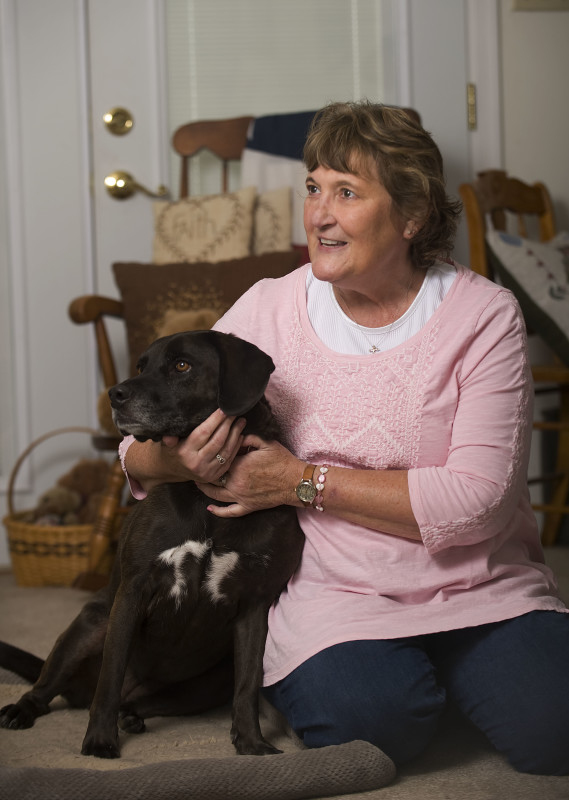 Joyce Smart, of Toms Brook, is a breast cancer survivor who credits her faith, family, friends and rescue dog Midnight for helping her cope with the disease. Rich Cooley/Daily