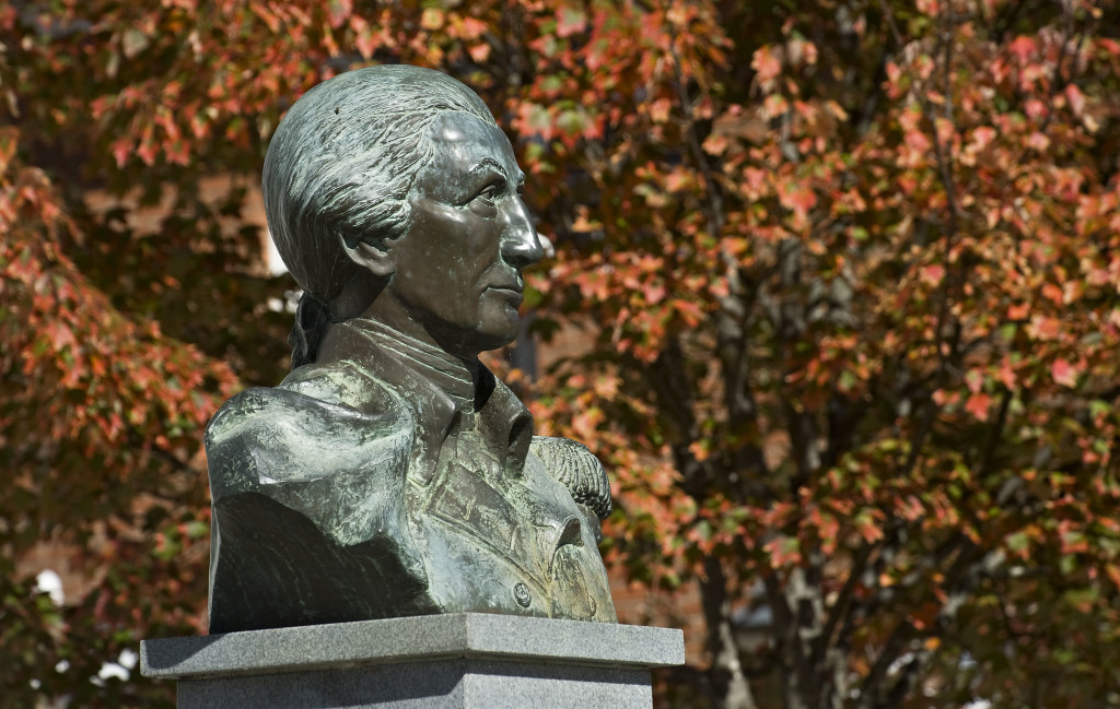 Fall is finally showing its colors, as seen behind the Peter Muhlenberg bust outside the old Shenandoah County Courthouse at Main and Court streets in Woodstock. Rich Cooley/Daily