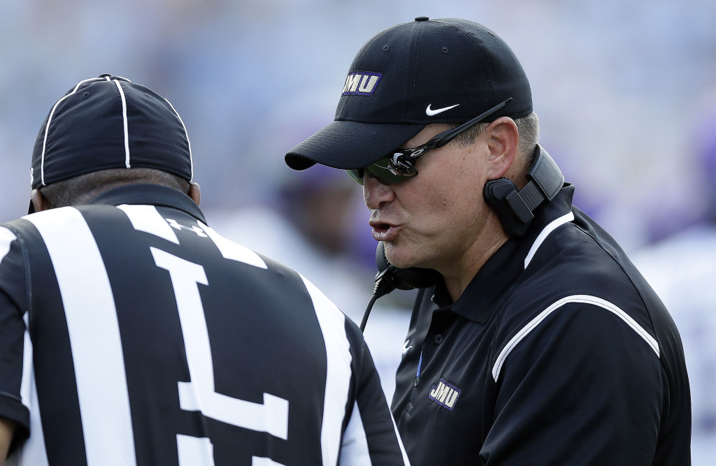 James Madison head coach Mike Houston, right, speaks with an official in the first half of a game against North Carolina on Sept. 17 in Chapel Hill, N.C., The Dukes play at New Hampshire on Saturday.