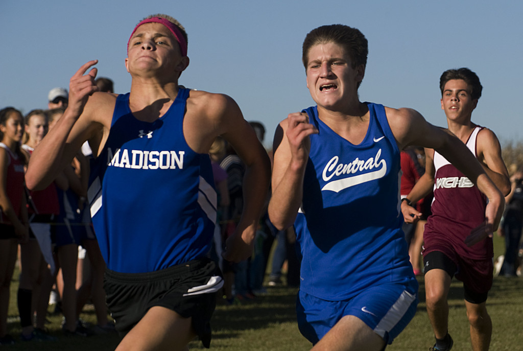 Madison's Zach McLearen edges out Central's Chase Rimel at the finish line by one second placing 13th and 14th respectively during the Bull Run District Cross Country meet  on Oct. 12 in Woodstock. The Falcons will be running in the state cross country meet today at Great Meadow in The Plains. Rich Cooley/Daily file