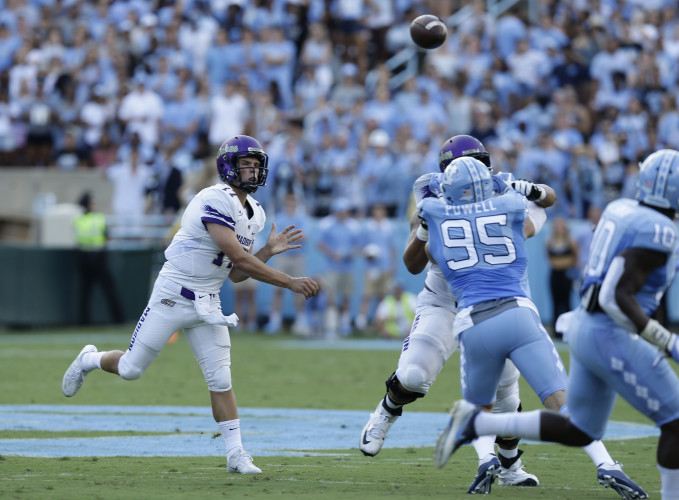 James Madison quarterback Bryan Schor passes against North Carolina on Sept. 17 in Chapel Hill, North Carolina. The Dukes play at New Hampshire today. The Wildcats have won 17 straight home games. AP file