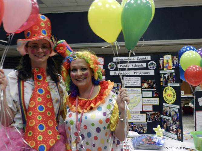 Speech Therapist Megan Hand, left, and Selena Rhoades, preschool services coordinator for Shenandoah County Public Schools, wore costumes for the Transition and Disabilities Resource Fair on Tuesday. They handed out free balloons while informing parents and teachers about the benefits of preschool. Kaley Toy/Daily
