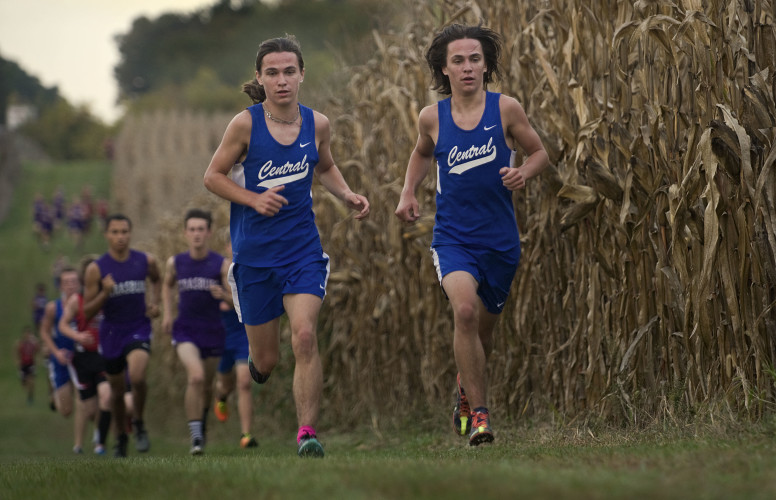 Central's Sawyer Lucy-Speidel, left, and his brother Mason, right, pace each other in the early part of the Shenandoah County meet in Woodstock on Wednesday. Mason placed first in the event and Central's team won the meet.  Rich Cooley/Daily