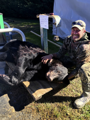 Bobby Spiker, of Maurertown, poses with the 493-pound black bear he killed recently on private land near Maurertown. Courtesy photo