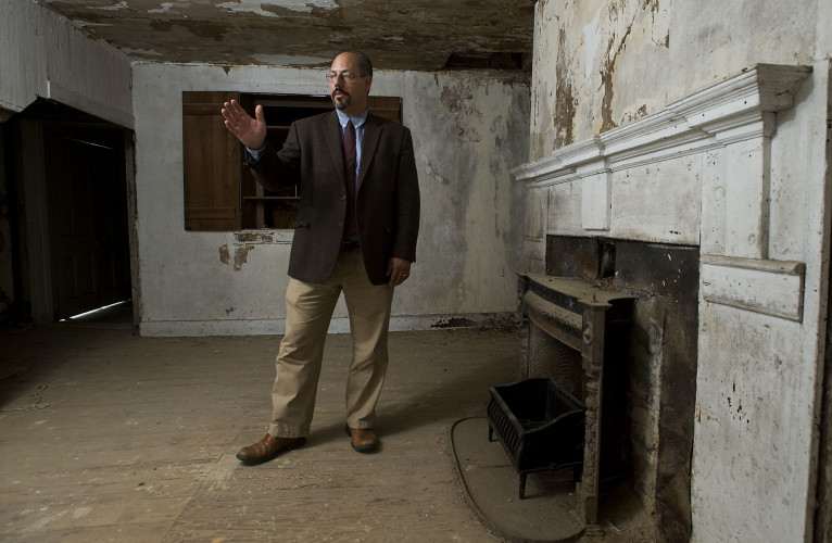 Patrick Farris, executive director of the Warren Heritage Society, stands inside one of two parlors Thursday inside the original 1820 Fairview House, also known locally as the McKay House, located off Winchester Road in Front Royal. The county has received a grant to fix the roof of the building and make other exterior repairs on what is believed to be the second oldest home in the county. Rich Cooley/Daily
